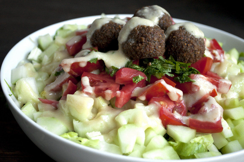 Falafel, tahini and salad in a bowl
