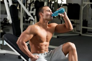 Muscular Man Drinking Water to Stay Hydrated