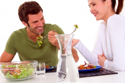 couple eating healthy salad together