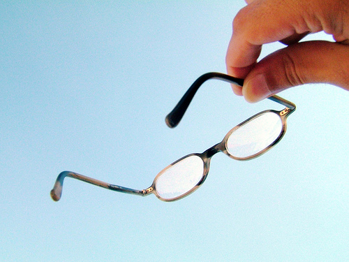 eye glasses or spectacles pointing at the sky