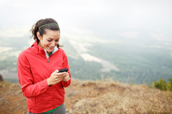 female hiker using smartphone