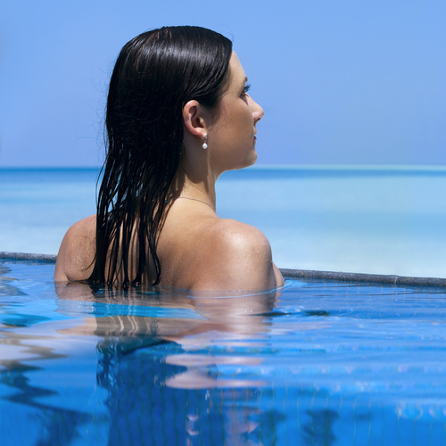 woman with beautiful hair swimming in water