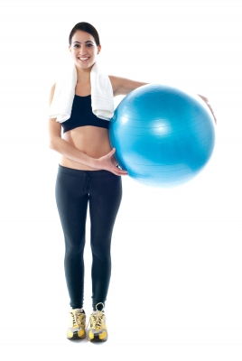 active after baby; mum holding exercise ball