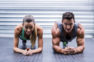 man and woman doing push ups